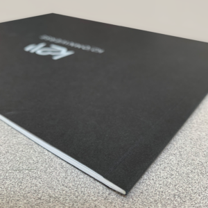 Thin perfect bound booklet-blackcover with white ink from SLB Printing in Los Angeles